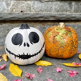 painted halloween pumpkins, once white, one gold