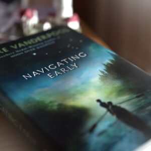 Cover of book Navigating Early by Clare Vanderpool depicting two teens in a rowboat on the water