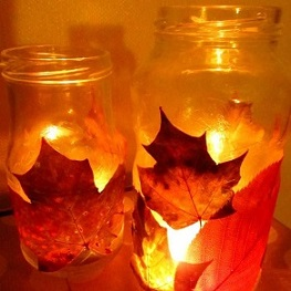 leaves pasted to mason jar with candle inside