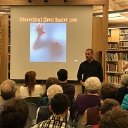Connecticut Ghost Hunter presenting PowerPoint to a crowd at the Library