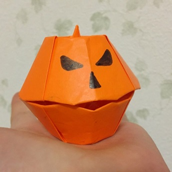 jack o'lantern formed with origami paper