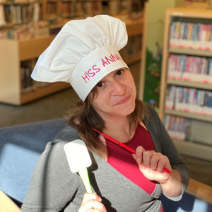 Miss Anna with a Chef's Hat on holding a spatula