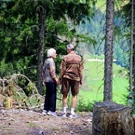 senior couple walking in woods
