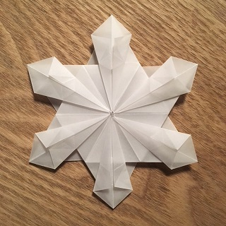 origami paper folded into a snowflake