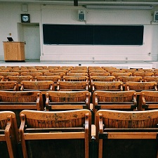 empty college classroom with chairs and blackboard
