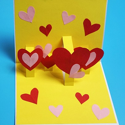 yellow 3-D card with hearts