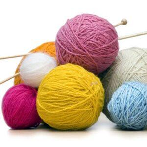 balls of yarn with knitting needles