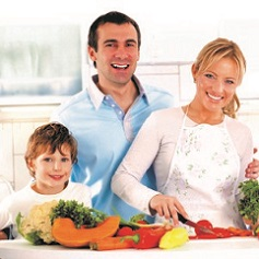 Family cutting fresh vegetables