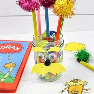lorax craft - pencil cup with lorax face and pencils that look like truffula trees