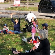 families participating in storytime on the lawn