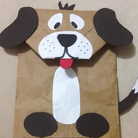 paper bag decorated to look like a dog