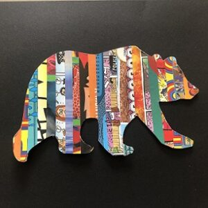 outline of a bear decorated with strips of magazine paper