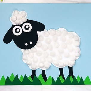sheep made from cotton balls pasted on construction paper