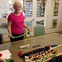Woman demonstartiing braided dog pull toys