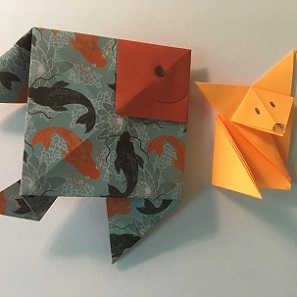 origami paper shaped into a fish and a fox