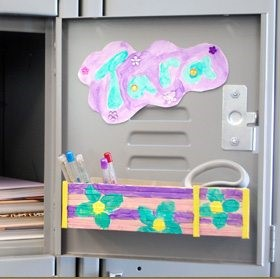 inside of school locker door with decorated self made pencil holder