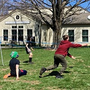 teens playing volleyball on the lawn
