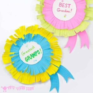 colorful paper rosettes with the words Greatest Gramps and Best Grandma on them