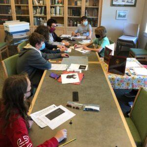 masked teens playing Dungeons & Dragons