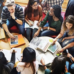 teens sitting in circle planning activities