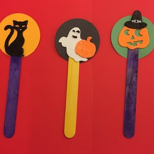 halloween-themed bookmarks made from craft sticks and construction paper