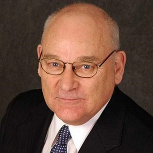 Vern Hayden: man with glasses wearing a suit and tie