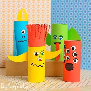 empty toilet paper rolls colored with markers and decorated with stickers eyes to look like silly monsters