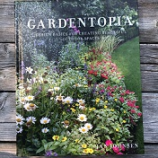 """""""Gardentopia"""" book cover with beautiful garden on the front"""