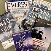 Five books about Mt Everest arranged on a table